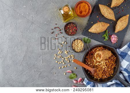 Uncooked Kibbeh Of Ground Beef Meat Mixed With Bulgur, Fried Minced Meat With Pine Nuts, Spices , Ga