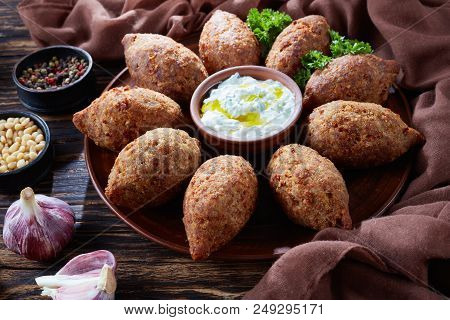 Deep Fried Kibbeh Of Ground Beef Meat Mixed With Bulgur, Stuffed With Fried Minced Meat With Pine Nu