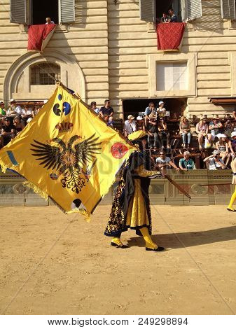 Siena, Italy - July 02, 2012: Tourists Watching The Colorful And Fancy Traditional Costume Parades A