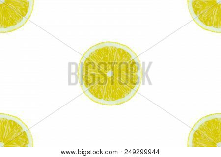 Close-up Of Yellow Sliced Lemon Fruits An A White Clean Background. View From Above To Halved Lemons
