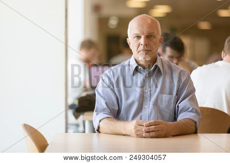 Seated Senior Man Calmly Looking