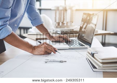 Construction Concept, Hands Of Architect Or Engineer Working For New Project Plan On Blueprint, Mode