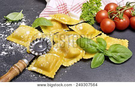 Ravioli Pasta, Homemade Pasta And Pasta Roller On A Stone Background. Italian Cuisine, Fresh Pasta C