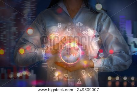 Woman Holding Abstract Neon Symbol Of Planet Earth Which Surrounded By Communication Icons. Business