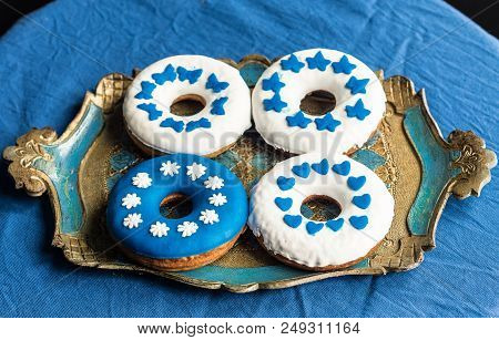 Homemamde Doughnuts Decorated With White And Blue Sugarpaste
