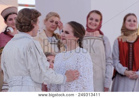 ST. PETERSBURG, RUSSIA - JULY 12, 2018: Olga Cheremnykh as Marfa (right) and Ilya Selivanov as Lykov in the opera The Tsar's Bride outdoors during the festival All Together Opera