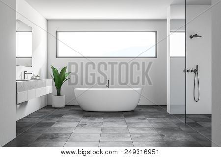 Luxury Bathroom Interior With White Walls, A Tiled Black Floor, A White Bathtub, A Shower And A Doub