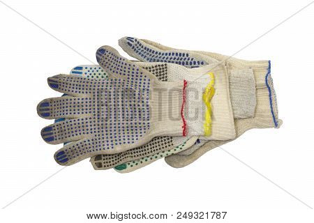 Stack Of Knitted Working Gloves With Colorful Rubber Dots, Neatly Arranged On The White Background.
