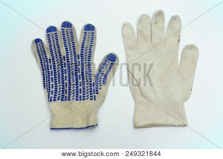 Protective Gloves Of White Fabric. Intended For Manual Labor. Pair With Blue Rubber Dots On Working