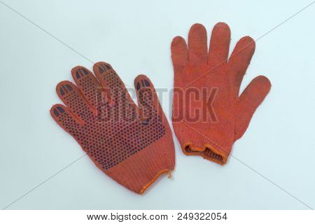 Work Gloves Of Orange-red Cotton. One Is Turned Inside Out. Pair With Stretchable Cuff With Bright O