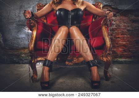 Sensual Provocation Of A Sexy Bdsm Woman In Lingerie On An Armchair