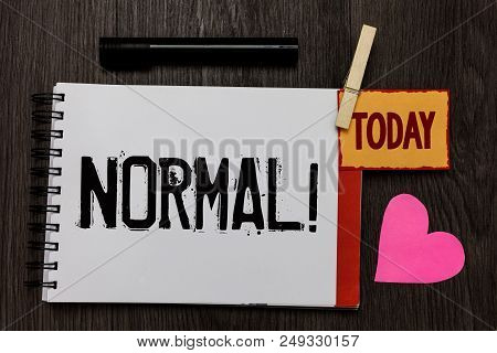 Word writing text Normal Motivational Call. Business concept for conforming to a standard Usual Typical or Expected Work register notebook clipped remember card love heart table background poster