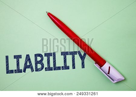 Handwriting Text Liability. Concept Meaning State Of Being Legally Responsible For Something Respons