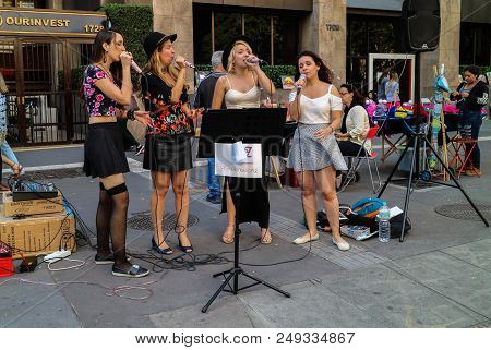 Girl Band Singing At The Paulista Avenue On Sunday Time