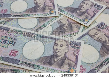 Japanese 10,000 Yen Banknotes Business And Finance Concept Background