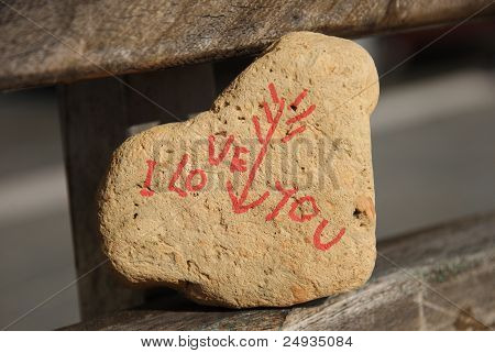 I love you message on a stone on a public bench