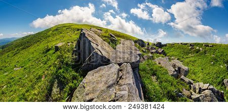 Panorama Of Gorgeous Mountainous Summer Landscape. Huge Rocky Formations On The Steep Grassy Slopes.
