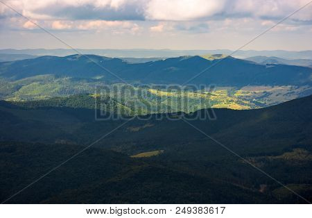 Beautiful Mountainous Landscape Background. Peaceful Nature Scenery. Clouds Over The Ridge And Light