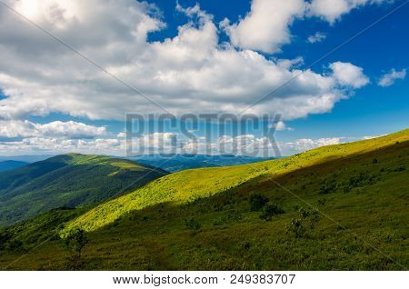 Beautiful Mountainous Landscape Under The Summer Sky. Fluffy Clouds Over The Mountain Ridge. Light O