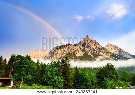 Rainbow Over The Ehrwalder Sonnenspitze Mountain In The Austrian Alps - Ehrwald, Tyrol, Austria.