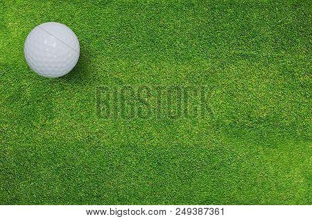 Golf Ball On Green Grass Of Golf Course. Golf Sport Background.
