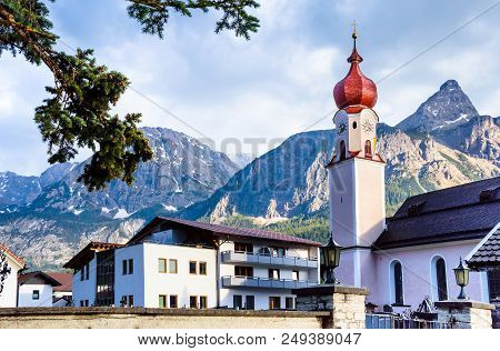 Parish Church Of Maria Heimsuchung With Mountains In The Background - Ehrwald, Tyrol, Austrian Alps