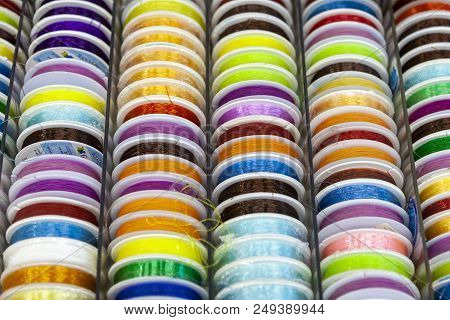 Rocks With Colorful Stitching For Clother, Sewing And Darning. Background. Colorful Nylon And Synthe
