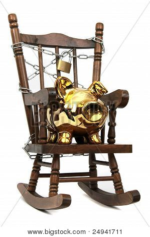 Old Wooden Rocking Chair And Piggy Bank Captured With Chain And Padlock On White