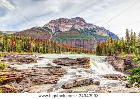 Athabasca Falls In Autumn Colors At Jasper National Park On The Icefields Parkway In Alberta, Canada