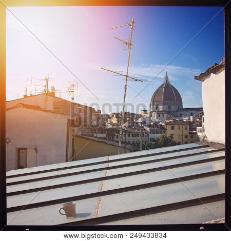 Coffe With Sunrise In Florence. On The Background, The Brunelleschi Dome.