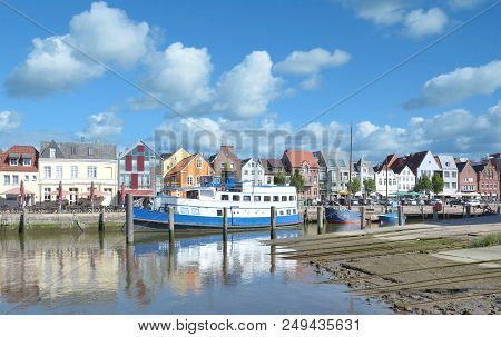 Town And Promenade In Husum Called Husumer Au,north Sea In North Frisia,schleswig-holstein,germany