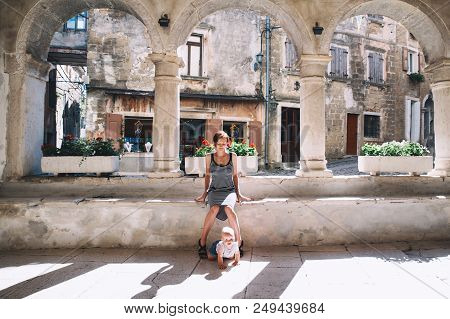 Young Woman And Baby In Historical Town Of Groznjan, Croatia, Europe. Mother With Cute Little Child