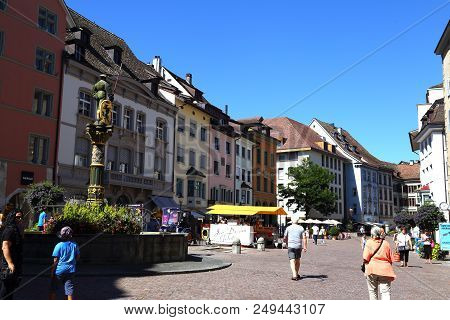 24.08.2016. Ancient City  Schaffhausen, Switzerland. Old Town. Tourists On A Street With Historical