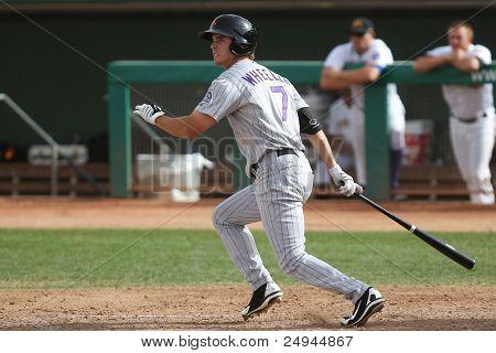 MESA, AZ - NOVEMBER 4: Salt River Rafters outfielder Tim Wheeler gets a hit in a game against the Mesa Solar Sox at Hohokam Park on November 4, 2011 in Mesa, AZ.