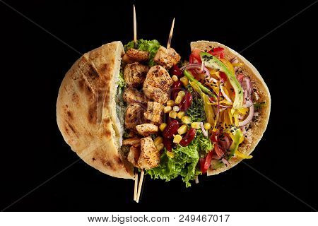 Tasty Jewish Pita Stuffed With Grilled Chicken, Vegetables, Letucce And Kebab On Vintage Wooden Back