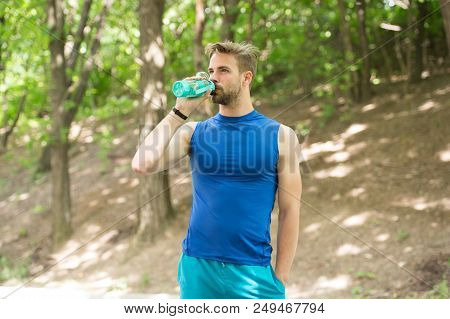Drinking Water. Man Drinking Water After Training. Man Drinking Healthy Water. Sportsman Has Thirst