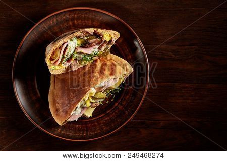 Tasty Jewish Pita Stuffed With Grilled Meat, Ham, Cheese, Piccoli And Sauce On Vintage Wooden Backgr