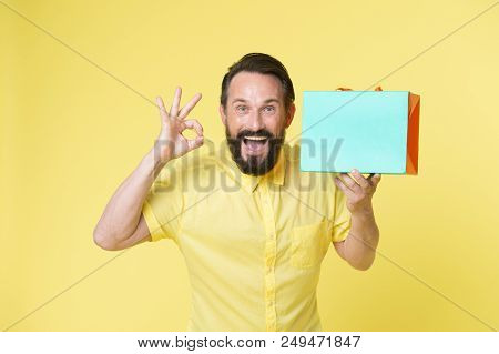 Presenting Your Product. Happy Man Hold Shopping Bag And Presenting Product. Copy Space Play For Pre