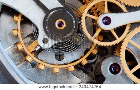 Clock Transmission Macro View. Stopwatch Chronometer Mechanism Cogs Gears Wheels Connection Concept.
