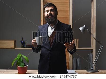 Silhouette Of Smiling Friendly Businessman Drinking Coffee In Office. Hot Coffee. Hot Drinks. Portra