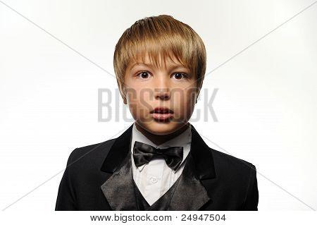 Boy in Tuxedo Looking Surprised
