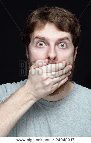 Secret concept - young man amazed by gossip news