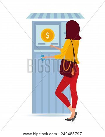 Beautiful Fashionable Girl, Stands Near The Atm Money Terminal, Holding A Payment Bank Card In Her H