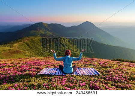 Colorful Carpet. The Yoga Girl In The Lotus Pose. The Lawn With The Rhododendron Flowers. High Mount