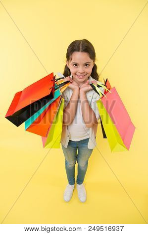 Sale. Small Girl With Shopping Bags After Sale. Black Friday Sale. Big Sale On Cyber Monday