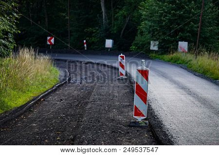 Close-up Of The Process Of Repair Of The Road Paving Road Asphalt Application