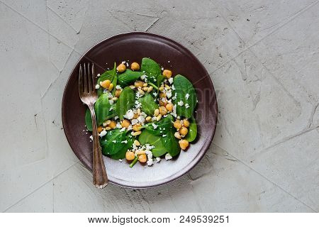 Salad In Plate. Energy Boosting Salad With Spinach Leaves, Chickpeas, Pine Nuts And Feta Cheese On L