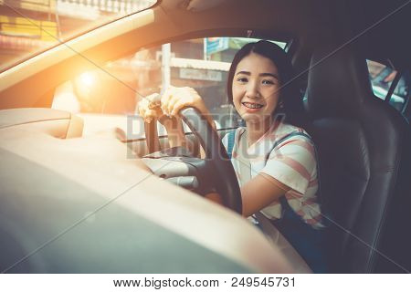 Young Asian Woman Driving Car Keeps Wheel Turning Around Smiling Looking Car Front. Vehicle Exam Con