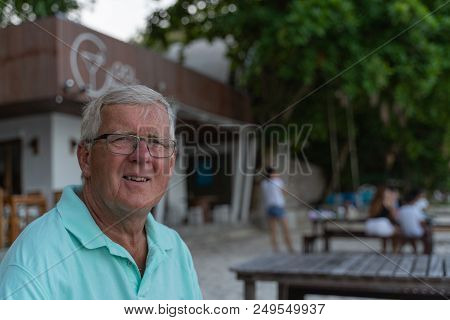 Close Up Face Portrait Older Depressed Man At The Beach
