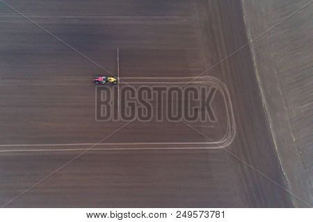 Tractor Spraying The Pesticides On The Field